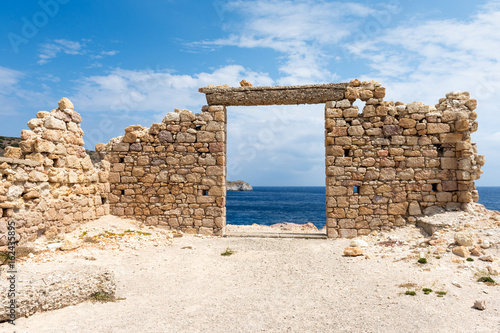 Fotobehang Rudnes The ruins of an ancient building in the picturesque village of Firopotamos on Milos Island. Cyclades, Greece.
