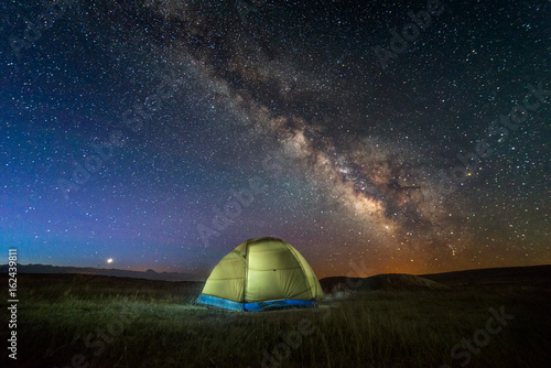Poster UFO An illuminated tent under the milky way.