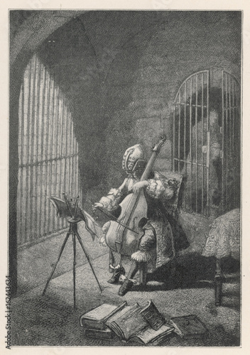 Photo  Man in the Iron Mask  playing the cello in prison