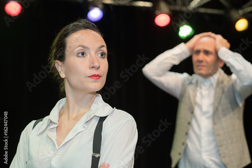 male and woman theatre actors on stage