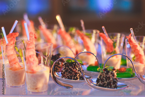 Fotobehang Voorgerecht Decorated catering banquet table with different food appetizers assortment on a party
