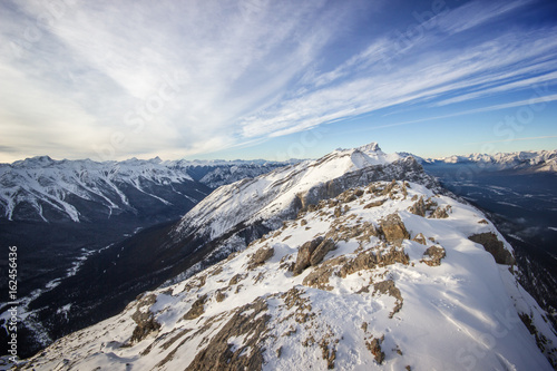 Fototapeta View to a deep winter valley from top of the high mountain ridge, Banff national park, Canada