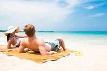 Couple Lying On White Sand Bea...