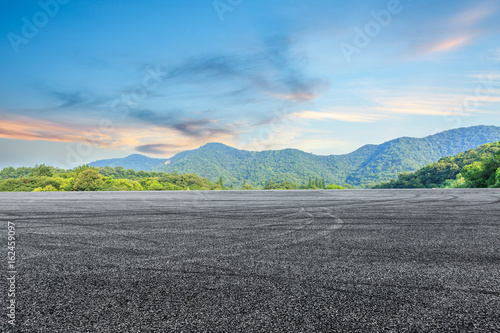 Poster Olive asphalt road and mountain background