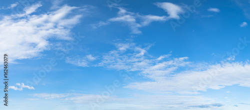 Panorama of blue sky background with white clouds on a sunny day Wallpaper Mural