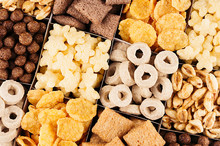 Corn Flakes Set -  Rings, Stars, Balls, Chocolate As Decorative Cereals Background. Top View.