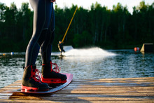 Men's Feet On A Wakeboard