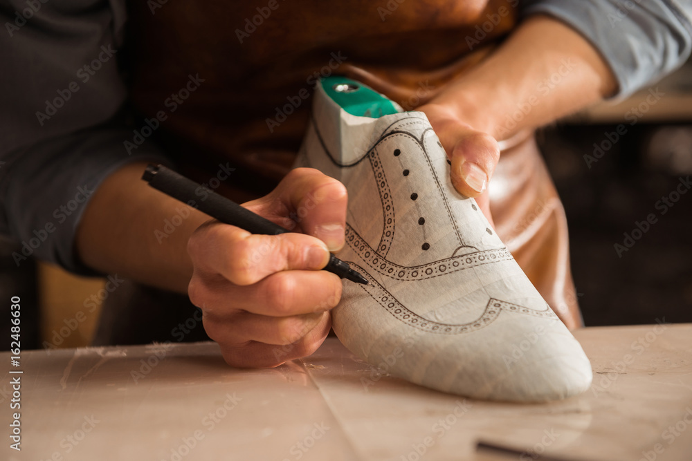 Fototapety, obrazy: Close up of a male shoemaker drawing design