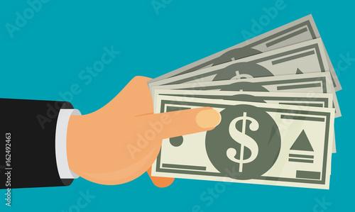 Valokuva  Hands holding money bills. Flat style