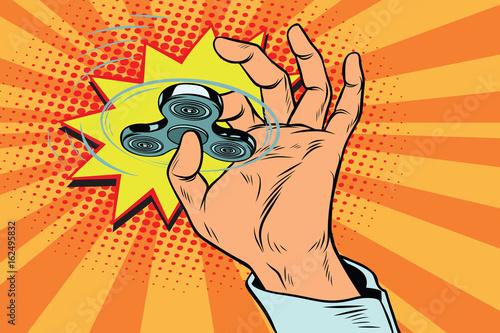 Fototapeta fidget spinner hand rotation