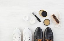 Two Pairs Of Shoes, Shoe Polish And Brush On White