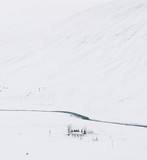 Icelandic winter minimalism: lonely house by the mountain and wild river, covered in snow - 162500609