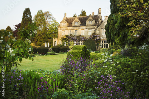 Exterior view of 17th century country house from garden