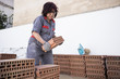 65 years old woman works on small reforms of masonry and electricity. Jaen, Spain