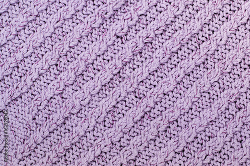 d50090d3c27d5 Sweater or scarf fabric texture large knitting. Knitted jersey background  with a relief pattern. Braids in knitting . Wool hand- machine