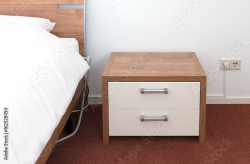 Photo Bed and bedside table