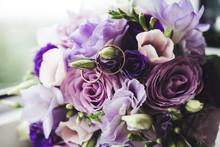 Wedding Rings On Perple Flowers