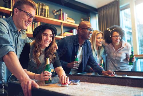 Valokuva  Group of friends having fun at bar