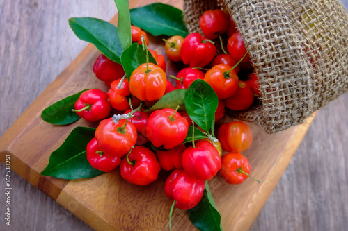 Acerola fruit close up on background. Canvas Print