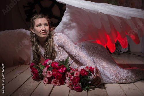 04e5a331b Ugly woman in a white dress with white wings - Buy this stock photo ...