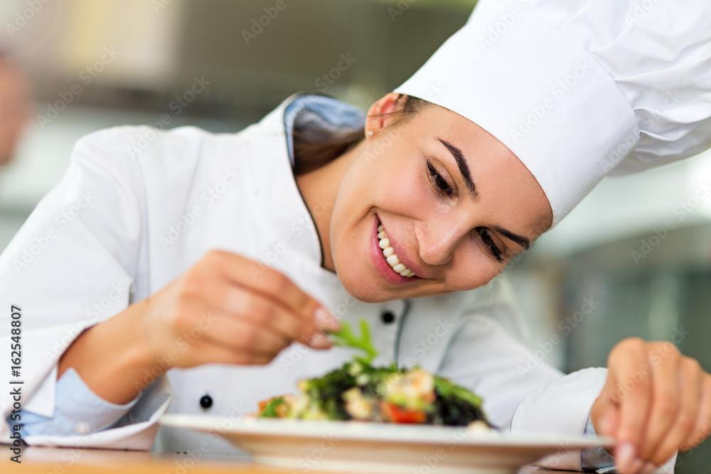 Fototapety, obrazy: Female chef in kitchen