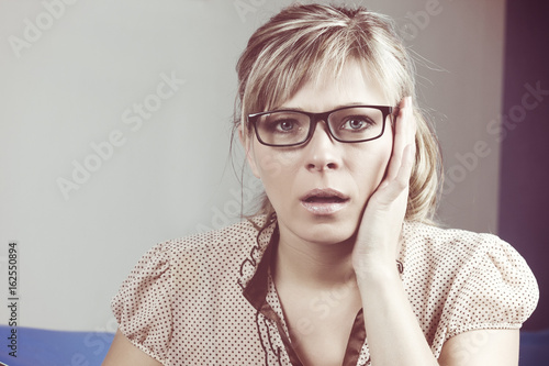 Fototapety, obrazy: Sadness woman with glasses angry shouts indoors.