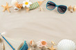 Composition with shells, sunglasses and toy ship on sand. Concept of travel and vacation