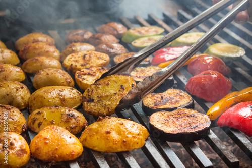 Fototapeta vegetables roast on a large grill obraz