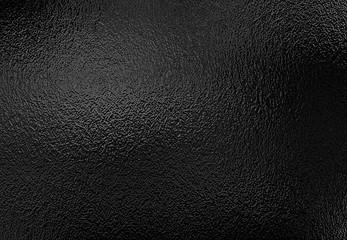 Tekstura tło błyszczącej czarnej folii metalowej