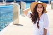 Leinwanddruck Bild - Beautiful young woman on vacation. Summer concept.