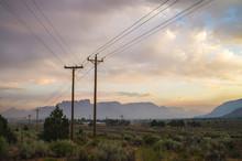 Powerlines With Desert Cliffs ...