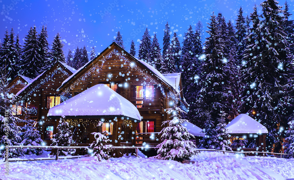 Fotografia A fairy-tale house in the woods amid the snow-covered fir trees, Christmas landscape