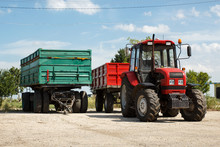 Red Tractor With Trailer And G...