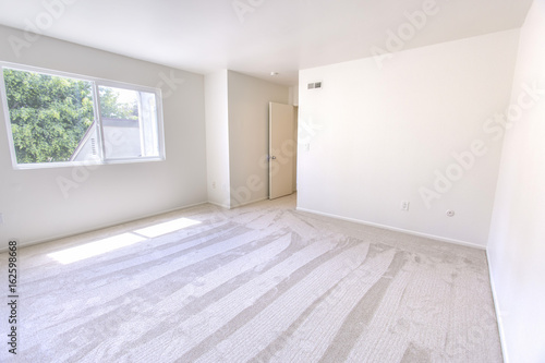 Empty Bedroom In A Model Home In Southern California Buy This