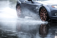 Sports Car Driven On Rainy Roa...