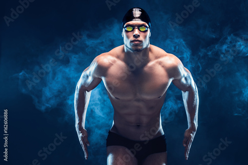 Attractive and muscular swimmer Fototapeta