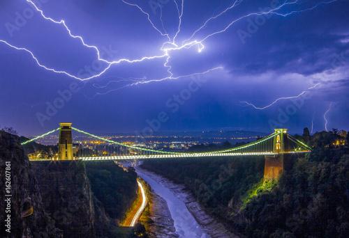 Fototapeta Lightning Over Suspension Bridge