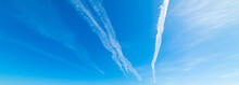 Contrails And Blue Sky