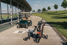 Empty Golf Cart And Golf Clubs In Bag On Walkway