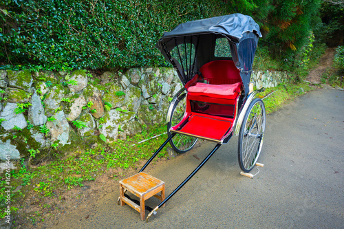 Fototapeta Japanese rickshaw at the bamboo forest of Arashiyama, Japan