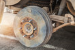Rusty wheel hub car with drum brake system and suspension during change wheel tyre