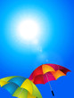 Sunny blue sky and umbrella background
