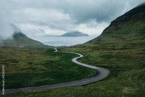 Windy road through mythical landscape