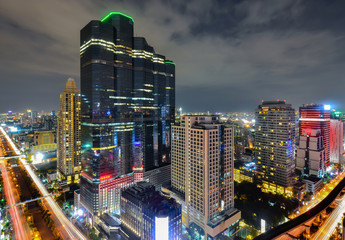 Fototapeta a view over the big asian city of Bangkok , Thailand at nighttime when the tall skyscrapers are illuminated