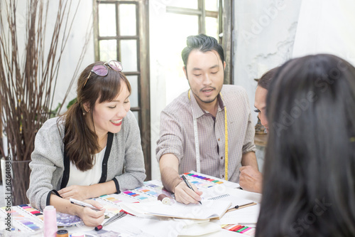 Young Team Asian Designer Warking At Studio Fashion Designer Carefully Creating New Fashionable Styles Dressmaker Makes Clothes Via Additional Part Time Job Buy This Stock Photo And Explore Similar Images At Adobe