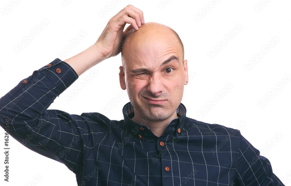 Fototapeta Confused bald guy scratch his head