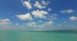 v07142 Maldives white sandy beach clouds on sunny tropical paradise island with aqua blue sky sea ocean 4k
