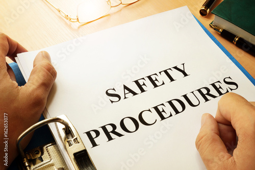 Valokuva  Safety procedures in a blue folder. Work Safety concept.