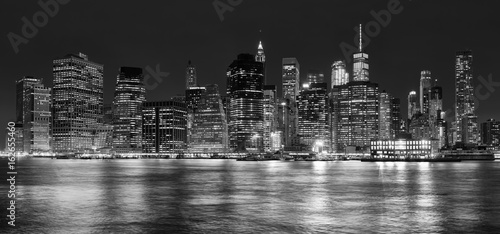 Black and white panoramic picture of Manhattan at night, New York City, USA.