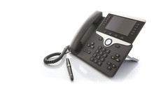 Modern Business Office IP Telephone With Pen On A White Background